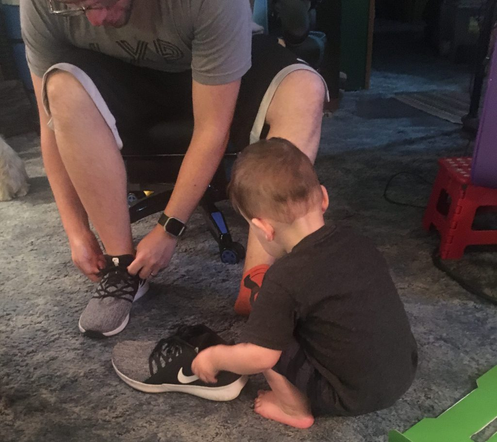 grandson helps dad with shoes  ~ Lifeofjoy.me
