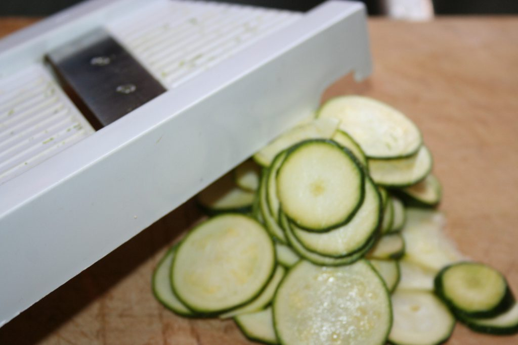 Slice Zucchini on mandolin ~ Lifeofjoy.me