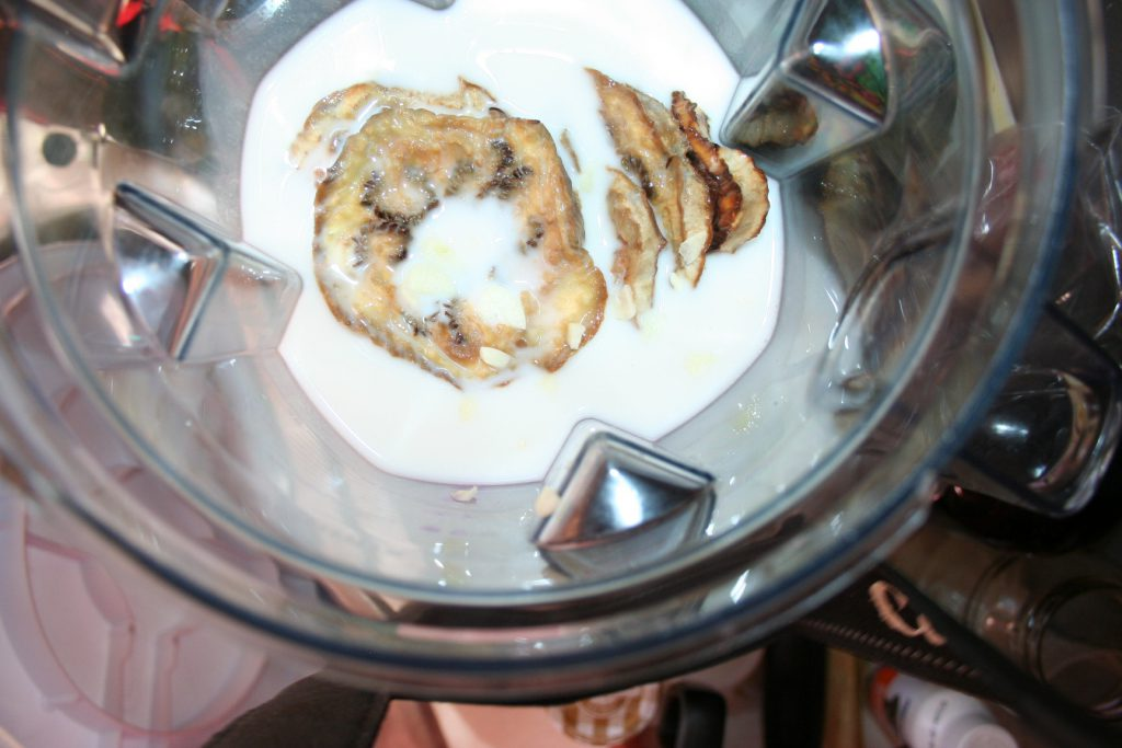 Add almond milk, eggplant, and garlic ~ Lifeofjoy.me